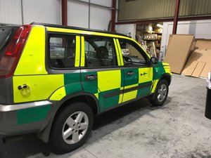 Vehicle Graphics with Reflective Safety Chevron Kit