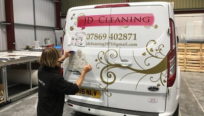 Rooster Bus Graphics installed at Creative Solutions