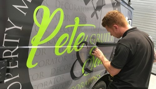 Close up of vehicle graphics install