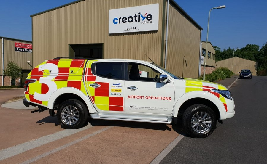Pick up Truck with reflective vehicle graphics